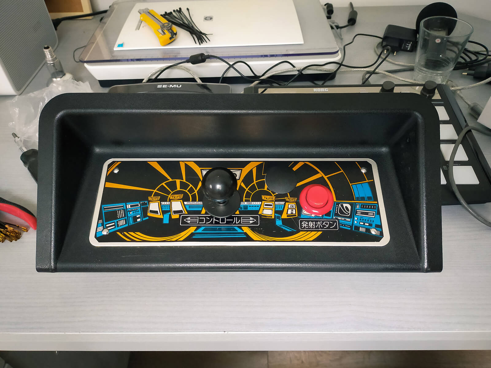 Control panel with a new joystick and button blank covering up an extra hole